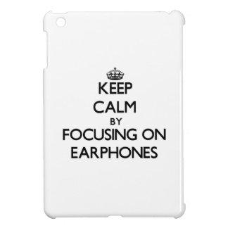 Keep Calm by focusing on EARPHONES iPad Mini Cases