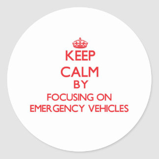 Keep Calm by focusing on EMERGENCY VEHICLES Classic Round Sticker