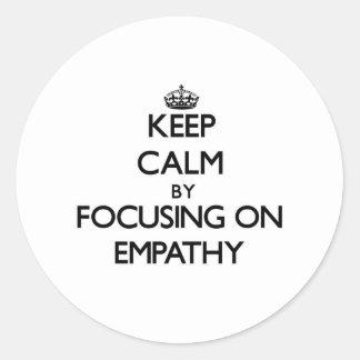 Keep Calm by focusing on EMPATHY Round Sticker