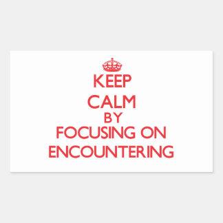 Keep Calm by focusing on ENCOUNTERING Rectangular Sticker