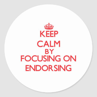 Keep Calm by focusing on ENDORSING Round Sticker