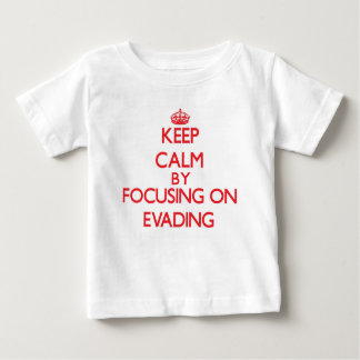 Keep Calm by focusing on EVADING T-shirts