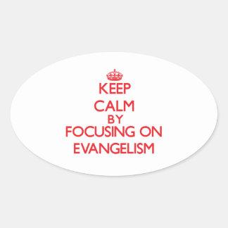 Keep Calm by focusing on EVANGELISM Oval Sticker