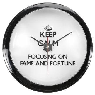 Keep Calm by focusing on Fame And Fortune Aquavista Clocks