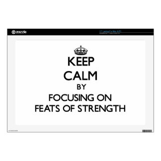 Keep Calm by focusing on Feats Of Strength Laptop Skin
