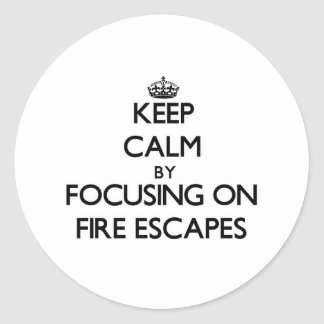 Keep Calm by focusing on Fire Escapes Round Sticker