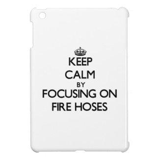 Keep Calm by focusing on Fire Hoses iPad Mini Covers