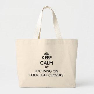 Keep Calm by focusing on Four Leaf Clovers Canvas Bag