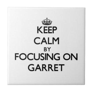 Keep Calm by focusing on Garret Tile