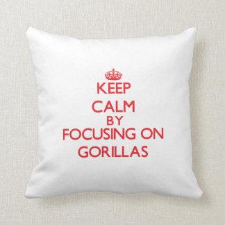 Keep calm by focusing on Gorillas Throw Pillow