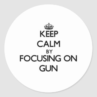 Keep Calm by focusing on Gun Sticker