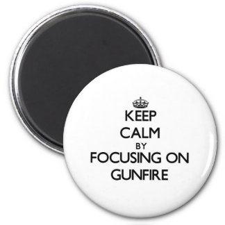 Keep Calm by focusing on Gunfire 2 Inch Round Magnet