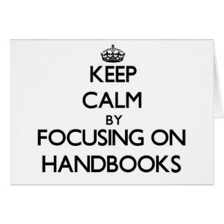 Keep Calm by focusing on Handbooks Greeting Card