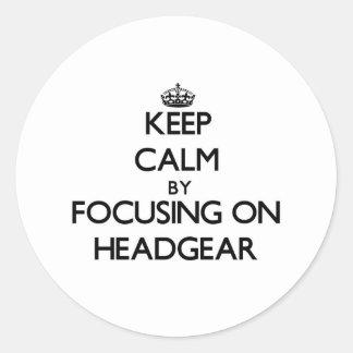 Keep Calm by focusing on Headgear Round Sticker