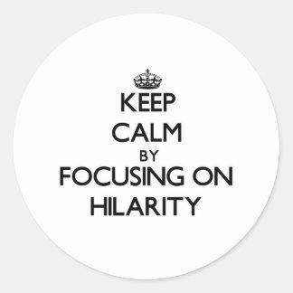 Keep Calm by focusing on Hilarity Round Sticker
