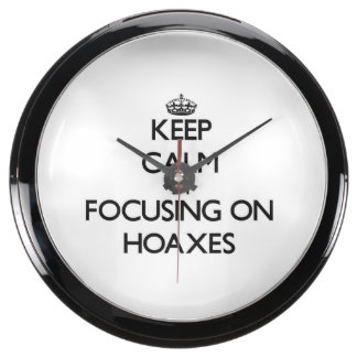 Keep Calm by focusing on Hoaxes Fish Tank Clock