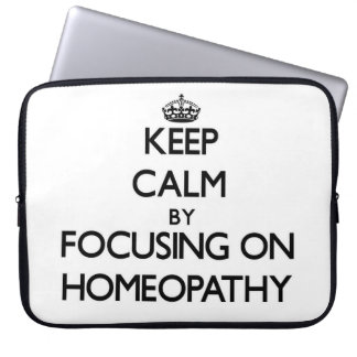 Keep Calm by focusing on Homeopathy Laptop Sleeves
