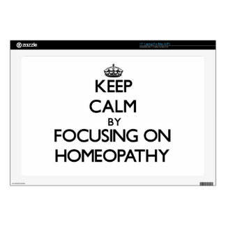 """Keep Calm by focusing on Homeopathy Skins For 17"""" Laptops"""