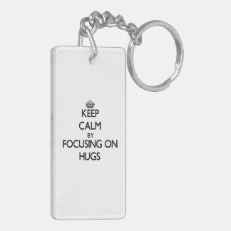 Keep Calm by focusing on Hugs Double-Sided Rectangular Acrylic Keychain