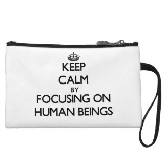 Keep Calm by focusing on Human Beings Wristlet Clutch