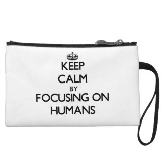 Keep Calm by focusing on Humans Wristlet Clutch