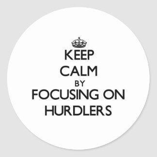 Keep Calm by focusing on Hurdlers Round Stickers