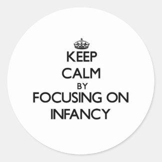 Keep Calm by focusing on Infancy Sticker