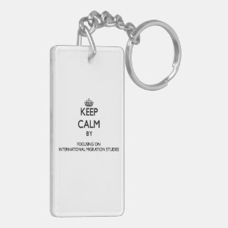 Keep calm by focusing on International Migration S Acrylic Key Chains