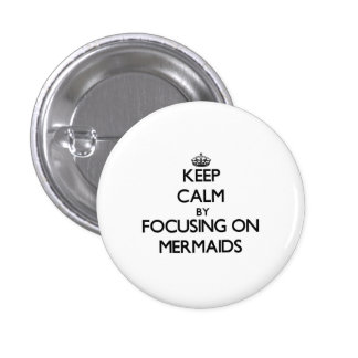 Keep Calm by focusing on Mermaids Pinback Button