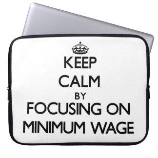 Keep Calm by focusing on Minimum Wage Laptop Sleeve