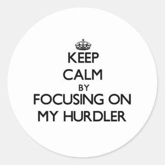 Keep Calm by focusing on My Hurdler Round Sticker