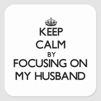 Keep Calm by focusing on My Husband Square Stickers