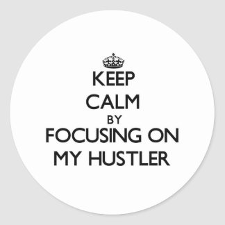 Keep Calm by focusing on My Hustler Classic Round Sticker