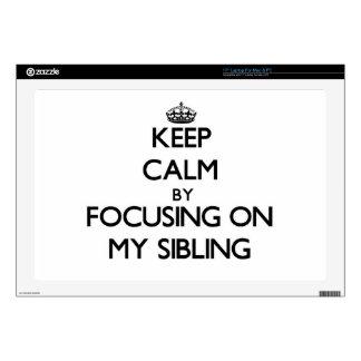"Keep Calm by focusing on My Sibling 17"" Laptop Skins"