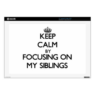 """Keep Calm by focusing on My Siblings Decals For 17"""" Laptops"""
