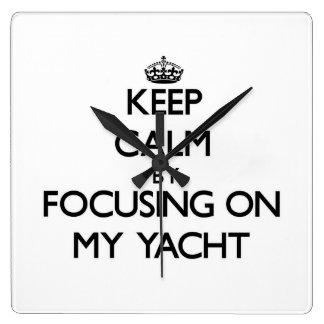 Keep Calm by focusing on My Yacht Square Wallclocks