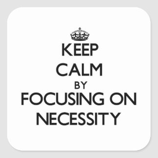 Keep Calm by focusing on Necessity Square Stickers