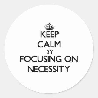 Keep Calm by focusing on Necessity Sticker