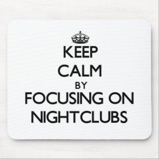 Keep Calm by focusing on Nightclubs Mousepad