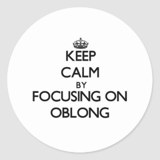 Keep Calm by focusing on Oblong Classic Round Sticker