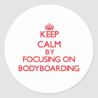 Keep calm by focusing on on Bodyboarding Classic Round Sticker