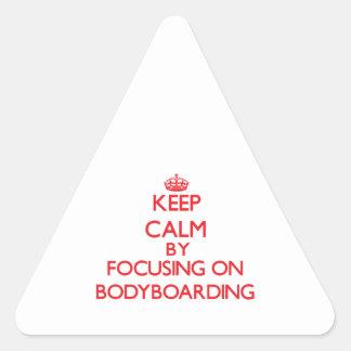 Keep calm by focusing on on Bodyboarding Triangle Sticker