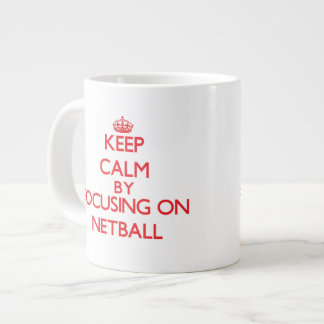 Keep calm by focusing on on Netball Extra Large Mugs