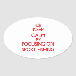 Keep calm by focusing on on Sport Fishing Oval Stickers
