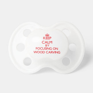 Keep calm by focusing on on Wood Carving Baby Pacifier