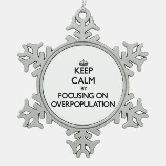 Keep Calm by focusing on Overpopulation Snowflake Pewter Christmas Ornament