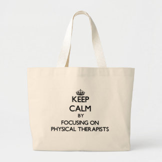 Keep Calm by focusing on Physical Therapists Tote Bags