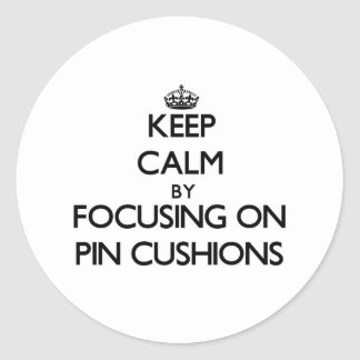 Keep Calm by focusing on Pin Cushions Round Sticker