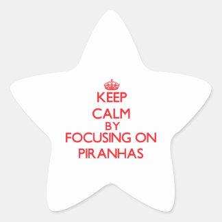 Keep calm by focusing on Piranhas Star Sticker
