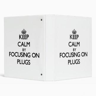 Keep Calm by focusing on Plugs Vinyl Binder